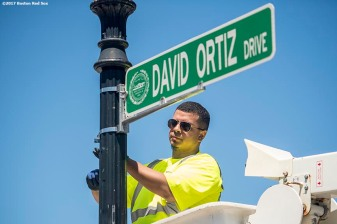 June 22, 2017, Boston, MA: A worker installs the new street sign during the unveiling of David Ortiz Drive, formerly known as Yawkey Way Extension, at Fenway Park in Boston, Massachusetts Thursday, June 22, 2017. (Photo by Billie Weiss/Boston Red Sox)