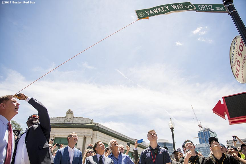 June 22, 2017, Boston, MA: Former Boston Red Sox designated hitter David Ortiz removes the covering to unveil David Ortiz Drive, formerly known as Yawkey Way Extension, at Fenway Park in Boston, Massachusetts Thursday, June 22, 2017. (Photo by Billie Weiss/Boston Red Sox)