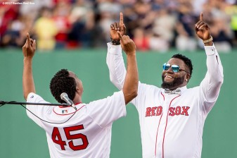 BOSTON, MA - JUNE 23: Former Boston Red Sox pitcher Pedro Martinez reacts with former designated hitter David Ortiz during a ceremony for the retirement of his jersey number before a game against the Los Angeles Angels of Anaheim on June 23, 2017 at Fenway Park in Boston, Massachusetts. (Photo by Billie Weiss/Boston Red Sox/Getty Images) *** Local Caption *** David Ortiz; Pedro Martinez