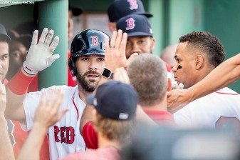 BOSTON, MA - JUNE 24: Mitch Moreland #18 of the Boston Red Sox high fives teammates after hitting a solo home run during the second inning of a game against the Los Angeles Angels of Anaheim on June 24, 2017 at Fenway Park in Boston, Massachusetts. (Photo by Billie Weiss/Boston Red Sox/Getty Images) *** Local Caption *** Mitch Moreland