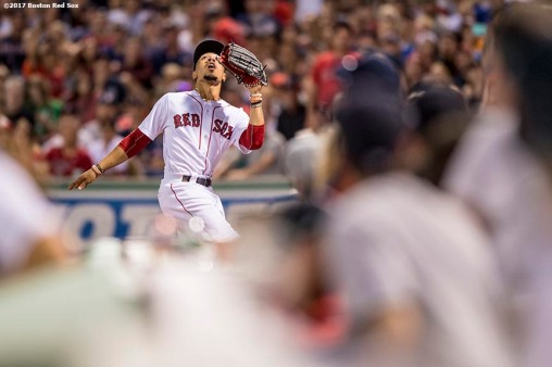 BOSTON, MA - JUNE 24: Mookie Betts #50 of the Boston Red Sox catches a fly ball during the seventh inning of a game against the Los Angeles Angels of Anaheim on June 24, 2017 at Fenway Park in Boston, Massachusetts. (Photo by Billie Weiss/Boston Red Sox/Getty Images) *** Local Caption *** Mookie Betts
