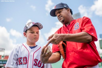 BOSTON, MA - JUNE 24: Former pitcher Pedro Martinez of the Boston Red Sox gives a pitching lesson as a Red Sox Foundation auction prize item before a game against the Los Angeles Angels of Anaheim on June 24, 2017 at Fenway Park in Boston, Massachusetts. (Photo by Billie Weiss/Boston Red Sox/Getty Images) *** Local Caption *** Pedro Martinez