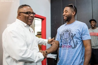 June 26, 2017, Boston, MA: Boston Red Sox center fielder Jackie Bradley Jr is greeted by Robert Lewis Jr. during a visit to The Base in West Roxbury, Massachusetts Monday June 26, 2017. (Photo by Billie Weiss/Boston Red Sox)