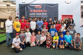 June 26, 2017, Boston, MA: Boston Red Sox center fielder Jackie Bradley Jr. poses for a group photograph with kids during a visit to The Base in West Roxbury, Massachusetts Monday June 26, 2017. (Photo by Billie Weiss/Boston Red Sox)