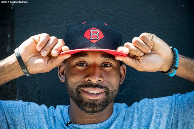 June 26, 2017, Boston, MA: Boston Red Sox center fielder Jackie Bradley Jr. poses for a portrait with a hat from The Base during a visit to The Base in West Roxbury, Massachusetts Monday June 26, 2017. (Photo by Billie Weiss/Boston Red Sox)