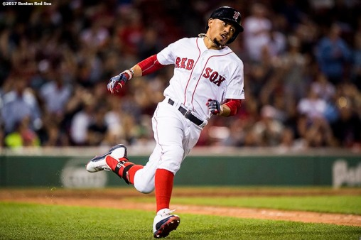 BOSTON, MA - JUNE 28: Mookie Betts #50 of the Boston Red Sox rounds first base after hitting a double during the ninth inning of a game against the Minnesota Twins on June 28, 2017 at Fenway Park in Boston, Massachusetts. (Photo by Billie Weiss/Boston Red Sox/Getty Images) *** Local Caption ***Mookie Betts