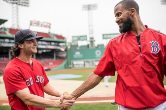 BOSTON, MA - JUNE 29: Andrew Benintendi #16 shakes hands with Chris Young #30 of the Boston Red Sox before a game against the Minnesota Twins on June 29, 2017 at Fenway Park in Boston, Massachusetts. (Photo by Billie Weiss/Boston Red Sox/Getty Images) *** Local Caption *** Chris Young; Andrew Benintendi