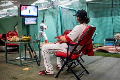 BOSTON, MA - JUNE 29: Andrew Benintendi #19 of the Boston Red Sox sits in the batting cage as Mookie Betts takes swings before a game against the Minnesota Twins on June 29, 2017 at Fenway Park in Boston, Massachusetts. (Photo by Billie Weiss/Boston Red Sox/Getty Images) *** Local Caption *** Andrew Benintendi; Mookie Betts