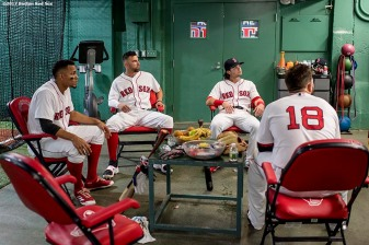 BOSTON, MA - JUNE 29: Xander Bogaerts #2, Deven Marrero #17, Andrew Benintendi #16, and Mitch Moreland #18 of the Boston Red Sox sit in the batting cage before a game against the Minnesota Twins on June 29, 2017 at Fenway Park in Boston, Massachusetts. (Photo by Billie Weiss/Boston Red Sox/Getty Images) *** Local Caption *** Xander Bogaerts; Andrew Benintendi; Deven Marrero; Mitch Moreland
