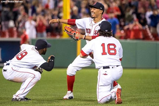BOSTON, MA - JUNE 29: Mookie Betts #50, Jackie Bradley Jr. #19, and Andrew Benintendi #16 of the Boston Red Sox celebrate a victory against the Minnesota Twins on June 29, 2017 at Fenway Park in Boston, Massachusetts. (Photo by Billie Weiss/Boston Red Sox/Getty Images) *** Local Caption *** Mookie Betts; Andrew Benintendi; Jackie Bradley Jr.