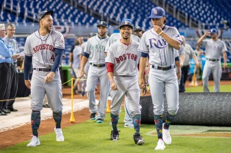 MIAMI, FL - JULY 10: Mookie Betts #50 of the Boston Red Sox reacts with teammates during Gatorade All-Star Workout Day at Marlins Park on July 10, 2017 in Miami, Florida. (Photo by Billie Weiss/Boston Red Sox/Getty Images) *** Local Caption *** Mookie Betts