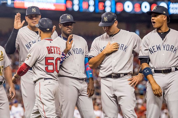 MIAMI, FL - JULY 11: Mookie Betts #50 of the Boston Red Sox high fives members of the New York Yankees during the 88th MLB All-Star Game at Marlins Park on July 11, 2017 in Miami, Florida (Photo by Billie Weiss/Boston Red Sox/Getty Images) *** Local Caption *** Mookie Betts