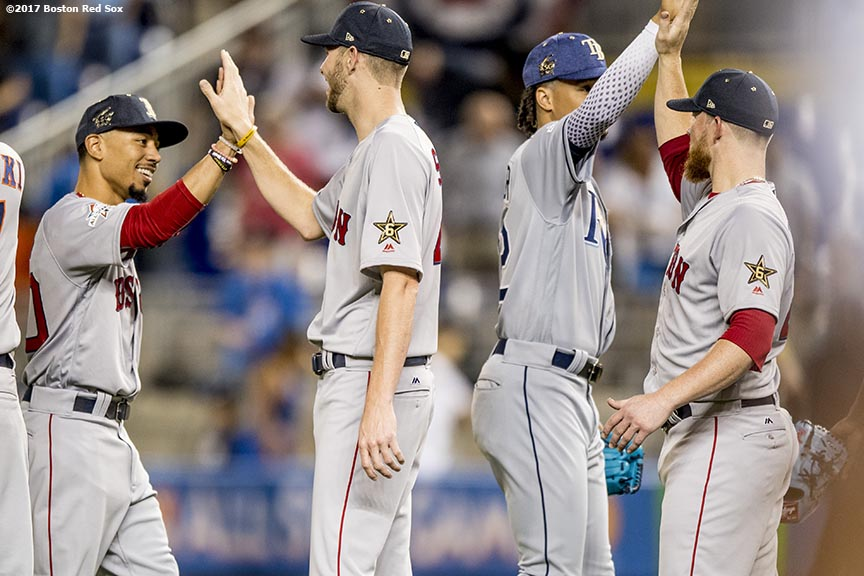 MIAMI, FL - JULY 11: Mookie Betts #50, Chris Sale #41, and Craig Kimbrel #46 of the Boston Red Sox celebrate a victory during the 88th MLB All-Star Game at Marlins Park on July 11, 2017 in Miami, Florida (Photo by Billie Weiss/Boston Red Sox/Getty Images) *** Local Caption *** Mookie Betts; Craig Kimbrel; Chris Sale