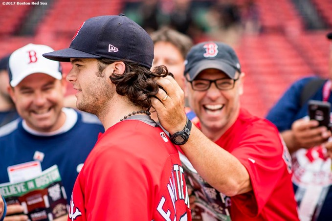 BOSTON, MA - JULY 14: A fan plays with the hair of Andrew Benintendi #19 of the Boston Red Sox before a game against the New York Yankees on July 14, 2017 at Fenway Park in Boston, Massachusetts. (Photo by Billie Weiss/Boston Red Sox/Getty Images) *** Local Caption *** Andrew Benintendi