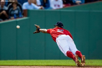 BOSTON, MA - JULY 14: Xander Bogaerts #2 of the Boston Red Sox dives as he attempts to catch a line drive during the third inning of a game against the New York Yankees on July 14, 2017 at Fenway Park in Boston, Massachusetts. (Photo by Billie Weiss/Boston Red Sox/Getty Images) *** Local Caption *** Xander Bogaerts
