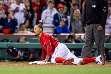 BOSTON, MA - JULY 14: Mookie Betts #50 of the Boston Red Sox slides as he steals third base during the ninth inning of a game against the New York Yankees on July 14, 2017 at Fenway Park in Boston, Massachusetts. (Photo by Billie Weiss/Boston Red Sox/Getty Images) *** Local Caption *** Mookie Betts