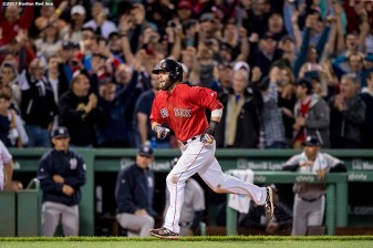 BOSTON, MA - JULY 14: Dustin Pedroia #15 of the Boston Red Sox runs toward home plate to score the game winning run on a walk-off walk to Andrew Benintendi #16 during the ninth inning of a game against the New York Yankees on July 14, 2017 at Fenway Park in Boston, Massachusetts. (Photo by Billie Weiss/Boston Red Sox/Getty Images) *** Local Caption *** Dustin Pedroia; Andrew Benintendi