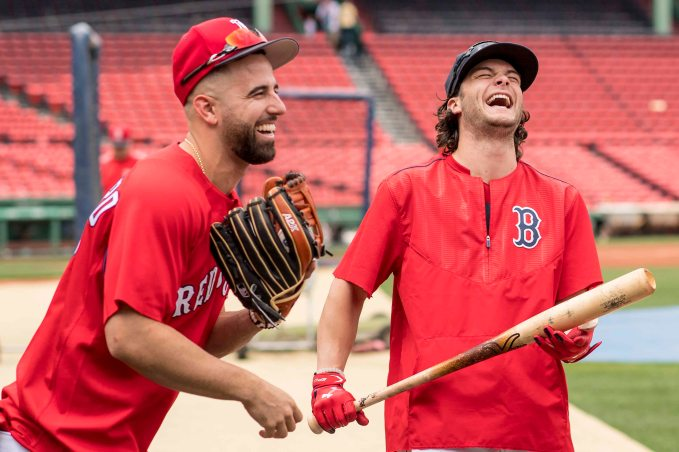 BOSTON, MA - JULY 15: Andrew Benintendi #16 and Deven Marrero #17 of the Boston Red Sox react before a game against the New York Yankees on July 15, 2017 at Fenway Park in Boston, Massachusetts. (Photo by Billie Weiss/Boston Red Sox/Getty Images) *** Local Caption *** Andrew Benintendi; Deven Marrero