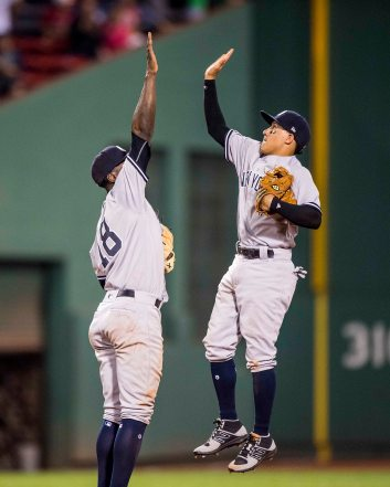 BOSTON, MA - JULY 15: Didi Gregorius #18 high fives Ronald Torreyes #74 of the New York Yankees after winning a 16 inning game against the Boston Red Sox on July 15, 2017 at Fenway Park in Boston, Massachusetts. (Photo by Billie Weiss/Boston Red Sox/Getty Images) *** Local Caption *** Didi Gregorius; Ronald Torreyes