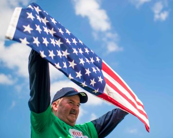 BOSTON, MA - JULY 15: A Veteran holds up an American flag during a ceremony honoring Vietnam Veterans before a game between the Boston Red Sox and the New York Yankees on July 15, 2017 at Fenway Park in Boston, Massachusetts. (Photo by Billie Weiss/Boston Red Sox/Getty Images) *** Local Caption ***
