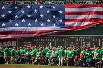 BOSTON, MA - JULY 15: The American Flag is dropped over the Green Monster as veterans are introduced onto the field during a ceremony honoring Vietnam Veterans before a game between the Boston Red Sox and the New York Yankees on July 15, 2017 at Fenway Park in Boston, Massachusetts. (Photo by Billie Weiss/Boston Red Sox/Getty Images) *** Local Caption ***