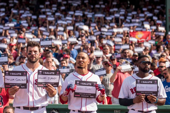 BOSTON, MA - JULY 15: Mitch Moreland #18, Mookie Betts #50, and Jackie Bradley Jr. #19 of the Boston Red Sox participate in a card stunt during a ceremony honoring Vietnam Veterans during a game against the New York Yankees on July 15, 2017 at Fenway Park in Boston, Massachusetts. (Photo by Billie Weiss/Boston Red Sox/Getty Images) *** Local Caption *** Mookie Betts; Mitch Moreland; Jackie Bradley Jr.