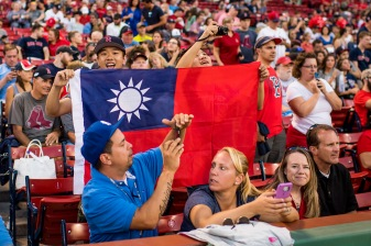 BOSTON, MA - JULY 16: Fans hold a flag in support of Tzu-Wei Lin #5 of the Boston Red Sox warms up before a game against the New York Yankees on July 16, 2017 at Fenway Park in Boston, Massachusetts. (Photo by Billie Weiss/Boston Red Sox/Getty Images) *** Local Caption *** Tzu-Wei Lin