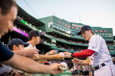 BOSTON, MA - JULY 16: Brock Holt #12 of the Boston Red Sox signs autographs before a game against the New York Yankees on July 16, 2017 at Fenway Park in Boston, Massachusetts. (Photo by Billie Weiss/Boston Red Sox/Getty Images) *** Local Caption *** Brock Holt