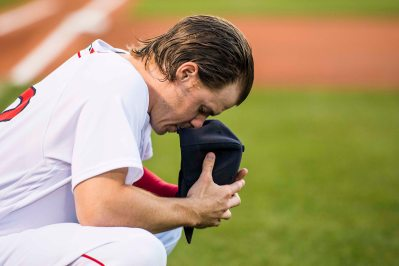 BOSTON, MA - JULY 16: Brock Holt #12 of the Boston Red Sox prays before a game against the New York Yankees on July 16, 2017 at Fenway Park in Boston, Massachusetts. (Photo by Billie Weiss/Boston Red Sox/Getty Images) *** Local Caption *** Brock Holt
