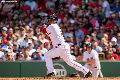 BOSTON, MA - July 30: Rafael Devers #11 of the Boston Red Sox hits a solo home run during the fifth inning of a game against the Kansas City Royals on July 30, 2017 at Fenway Park in Boston, Massachusetts. (Photo by Billie Weiss/Boston Red Sox/Getty Images) *** Local Caption *** Rafael Devers