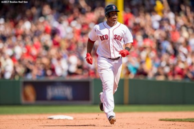 BOSTON, MA - July 30: Rafael Devers #11 of the Boston Red Sox rounds the bases after hitting a solo home run during the fifth inning of a game against the Kansas City Royals on July 30, 2017 at Fenway Park in Boston, Massachusetts. (Photo by Billie Weiss/Boston Red Sox/Getty Images) *** Local Caption *** Rafael Devers