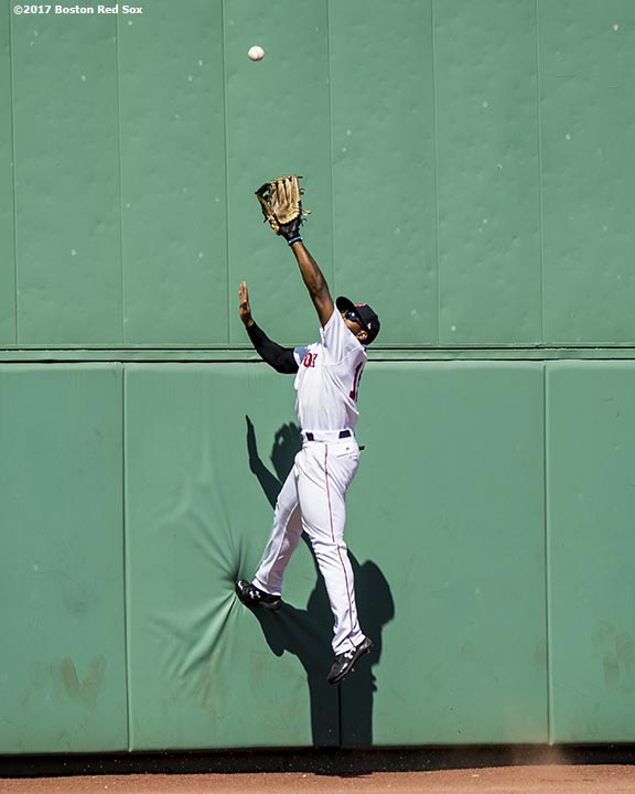 BOSTON, MA - July 30: Jackie Bradley Jr. #19 of the Boston Red Sox attempts to catch a line drive off of the wall during the sixth inning of a game against the Kansas City Royals on July 30, 2017 at Fenway Park in Boston, Massachusetts. (Photo by Billie Weiss/Boston Red Sox/Getty Images) *** Local Caption *** Jackie Bradley Jr.