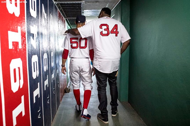BOSTON, MA - JULY 30: Former Boston Red Sox player David Ortiz walks through a hallway with Mookie Betts #50 of the Boston Red Sox before a 2007 World Series Champion team reunion before a game against the Kansas City Royals on July 30, 2017 at Fenway Park in Boston, Massachusetts. (Photo by Billie Weiss/Boston Red Sox/Getty Images) *** Local Caption *** Mookie Betts; David Ortiz