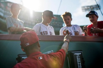 BOSTON, MA - JULY 31: Mookie Betts #50 of the Boston Red Sox signs autographs before a game against the Cleveland Indians on July 31, 2017 at Fenway Park in Boston, Massachusetts. (Photo by Billie Weiss/Boston Red Sox/Getty Images) *** Local Caption *** Mookie Betts