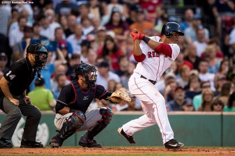 BOSTON, MA - JULY 31: Rafael Devers #11 of the Boston Red Sox hits a single during the second inning of a game against the Cleveland Indians on July 31, 2017 at Fenway Park in Boston, Massachusetts. (Photo by Billie Weiss/Boston Red Sox/Getty Images) *** Local Caption *** Rafael Devers