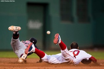 BOSTON, MA - JULY 31: Mookie Betts #50 of the Boston Red Sox steals second base as Francisco Lindor #12 of the Cleveland Indians dives for an overthrown ball during the second inning of a game on July 31, 2017 at Fenway Park in Boston, Massachusetts. (Photo by Billie Weiss/Boston Red Sox/Getty Images) *** Local Caption *** Mookie Betts; Francisco Lindor