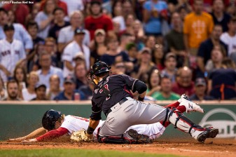BOSTON, MA - JULY 31: Brock Holt #12 of the Boston Red Sox is tagged out by Yan Gomes #7 of the Cleveland Indians as he attempts to score during the second inning of a game on July 31, 2017 at Fenway Park in Boston, Massachusetts. (Photo by Billie Weiss/Boston Red Sox/Getty Images) *** Local Caption ***