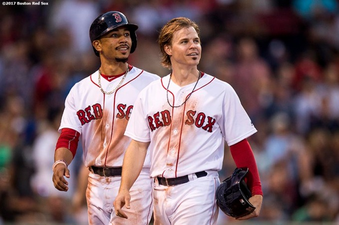 BOSTON, MA - JULY 31: Mookie Betts #50 and Brock Holt #12 of the Boston Red Sox react during the second inning of a game against the Cleveland Indians on July 31, 2017 at Fenway Park in Boston, Massachusetts. (Photo by Billie Weiss/Boston Red Sox/Getty Images) *** Local Caption *** Mookie Betts; Brock Holt