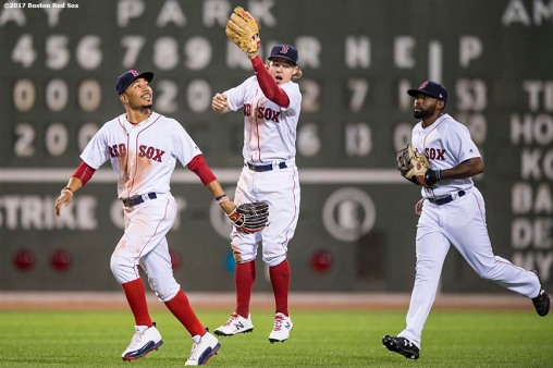 BOSTON, MA - JULY 31: Brock Holt #12, Jackie Bradley Jr. #19, and Mookie Betts #50 of the Boston Red Sox celebrate a victory against the Cleveland Indians on July 31, 2017 at Fenway Park in Boston, Massachusetts. (Photo by Billie Weiss/Boston Red Sox/Getty Images) *** Local Caption *** Brock Holt; Jackie Bradley Jr.; Mookie Betts