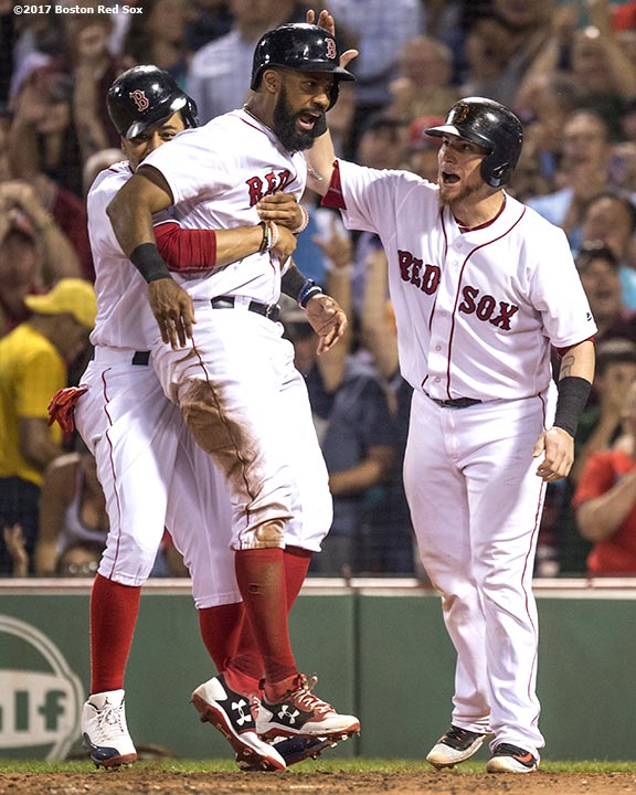 BOSTON, MA - AUGUST 1: Chris Young #30 of the Boston Red Sox reacts with Mookie Betts #50 and Christian Vazquez #7 after scoring during the sixth inning of a game against the Cleveland Indians on August 1, 2017 at Fenway Park in Boston, Massachusetts. (Photo by Billie Weiss/Boston Red Sox/Getty Images) *** Local Caption *** Chris Young; Christian Vazquez; Mookie Betts