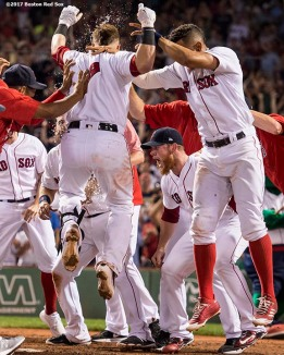 BOSTON, MA - AUGUST 1: Christian Vazquez #7 of the Boston Red Sox is mobbed by teammates after hitting a walk-off three run home run during the ninth inning of a game against the Cleveland Indians on August 1, 2017 at Fenway Park in Boston, Massachusetts. (Photo by Billie Weiss/Boston Red Sox/Getty Images) *** Local Caption *** Christian Vazquez