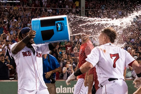 BOSTON, MA - AUGUST 1: Christian Vazquez #7 of the Boston Red Sox is doused with Powerade by Hanley Ramirez #13 after hitting a walk-off three run home run during the ninth inning of a game against the Cleveland Indians on August 1, 2017 at Fenway Park in Boston, Massachusetts. (Photo by Billie Weiss/Boston Red Sox/Getty Images) *** Local Caption *** Christian Vazquez; Hanley Ramirez