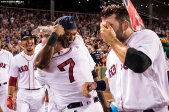 BOSTON, MA - AUGUST 1: Christian Vazquez #7 of the Boston Red Sox is mobbed by Hanley Ramirez #13, Mookie Betts #15, and Mitch Moreland #18 after hitting a walk-off three run home run during the ninth inning of a game against the Cleveland Indians on August 1, 2017 at Fenway Park in Boston, Massachusetts. (Photo by Billie Weiss/Boston Red Sox/Getty Images) *** Local Caption *** Christian Vazquez; Mookie Betts; Mitch Moreland; Hanley Ramirez