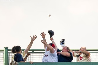 BOSTON, MA - AUGUST 3: Fans reach for a home run ball during batting practice before a game between the Boston Red Sox and the Chicago White Sox on August 3, 2017 at Fenway Park in Boston, Massachusetts. (Photo by Billie Weiss/Boston Red Sox/Getty Images) *** Local Caption ***