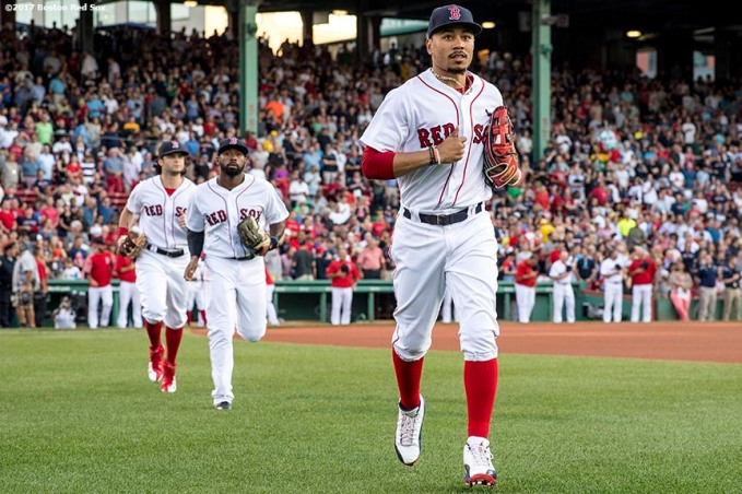 BOSTON, MA - AUGUST 3: Mookie Betts #50, Jackie Bradley Jr. #19, and Andrew Benintendi #16 of the Boston Red Sox take the field before a game against the Chicago White Sox on August 3, 2017 at Fenway Park in Boston, Massachusetts. (Photo by Billie Weiss/Boston Red Sox/Getty Images) *** Local Caption *** Mookie Betts; Andrew Benintendi; Jackie Bradley Jr.