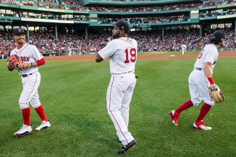 BOSTON, MA - AUGUST 3: Mookie Betts #50, Jackie Bradley Jr. #19, and Andrew Benintendi #16 of the Boston Red Sox react before a game against the Chicago White Sox on August 3, 2017 at Fenway Park in Boston, Massachusetts. (Photo by Billie Weiss/Boston Red Sox/Getty Images) *** Local Caption *** Mookie Betts; Andrew Benintendi; Jackie Bradley Jr.