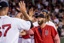 BOSTON, MA - AUGUST 3: Dustin Pedroia #15 of the Boston Red Sox high fives teammates after a victory against the Chicago White Sox on August 3, 2017 at Fenway Park in Boston, Massachusetts. (Photo by Billie Weiss/Boston Red Sox/Getty Images) *** Local Caption *** Dustin Pedroia