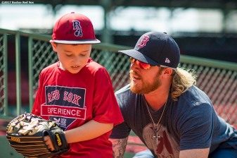 August 3, 2017, Boston, MA: Boston Red Sox pitcher Robbie Ross Jr. gives pitching instructions to a participant during a Sox Talk Clinic at Fenway Park in Boston, Massachusetts Thursday, August 3, 2017. (Photo by Billie Weiss/Boston Red Sox)