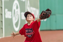 August 3, 2017, Boston, MA: A participant takes fielding practice off the green monster wall during a Sox Talk Clinic at Fenway Park in Boston, Massachusetts Thursday, August 3, 2017. (Photo by Billie Weiss/Boston Red Sox)