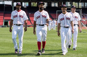 BOSTON, MA - AUGUST 4: Eduardo Nunez #36, Chris Young #30, Mookie Betts #50, an Josh Rutledge #32 of the Boston Red Sox react before taking the team photo before a game against the Chicago White Sox on August 4, 2017 at Fenway Park in Boston, Massachusetts. (Photo by Billie Weiss/Boston Red Sox/Getty Images) *** Local Caption *** Eduardo Nunez; Josh Rutledge; Mookie Betts; Chris Young